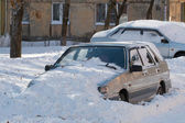 Car buried in snow. — Stock Photo
