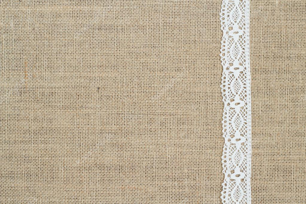 Burlap background with lace — Stock Photo © karissaa #39082531