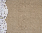 Burlap background with lace — ストック写真