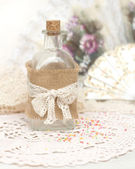 Shabby bottle and hand fan — Stock Photo