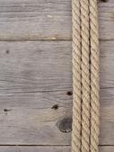 Rope on dark wood — Stock Photo