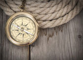 Exploring background with compass and rope — Stock Photo