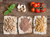 Pasta, vegetables and herbs on wood — Foto Stock
