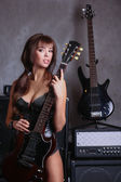Busty girl with guitar — Stock Photo
