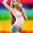 Girl with lollipop. a colorful background — Stock Photo #40358475