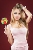Glamourous girl holding lollipop — Stock Photo