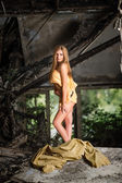 Girl in the yellow tissue on the ruins — Stock Photo