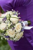 Bridal bouquet on wedding day — Stock Photo