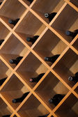 Cupboard with wine bottles — Stock Photo