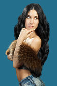 A young woman with a fur vest — Stock Photo