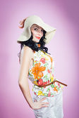Pin up girl in a big hat — Stock Photo