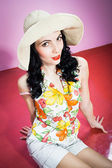 Pin up girl in a big hat — Stok fotoğraf