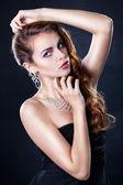 Beautiful girl with luxurious hair — Stock Photo