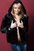 Zhenzhina in sexy short fur coat. — Stock Photo