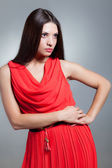 Girl in a red dress, emotion — Stock Photo