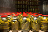 Gurtsov conservation. Fresh cucumbers in jars — Stock Photo