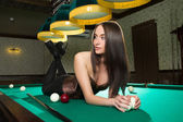 Sexy girl in corset plays billiards. — Photo