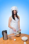 Sexy girl wearing chef prepares dough. — Stock Photo