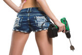 Girl holding a drill near the booty — Stock Photo