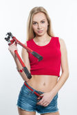 Girl in jeans chert. keeps working tools. pliers — Foto de Stock