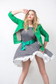 Girl in the developing dress and green jacket. — Stock Photo