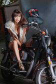 Beautiful girl is sitting on a motorcycle — Stock Photo