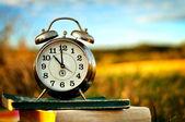 Old alarm clock over books — Stock Photo