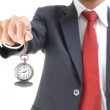 Businessman showing a pocket watch — Stock Photo