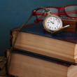 Vintage pocket watch and old books — Stock Photo #39416351