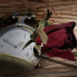 Stock Photo: Dried roses and pocket watch on wooden