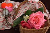 Still life of pink rose flower in basket — Stock Photo