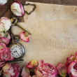 Dried roses pocket watch and old paper on wooden — Stock Photo #39820971