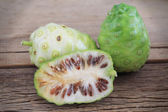 Morinda citrifolia or noni on wooden — Stock Photo