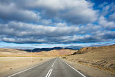 Road and clouds. — Stock Photo