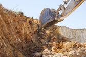 Excavator in exploitation — Stock Photo