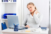 Neck pain at work — Stock Photo