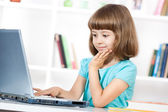 Little girl using laptop — Stock Photo
