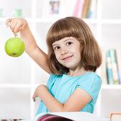 Little girl holding apple — Stock Photo
