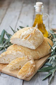 Homemade bread with olive oil — Stock Photo