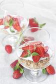 Yogurt with granola and strawberry — Stock Photo