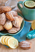 Madeleines with tea — Stock Photo