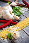 Pasta, garlic, pepper, basil and parmigiano — Stock Photo