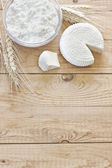 Cottage cheese, tzfat cheese and grains background — Stock Photo