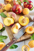 Apricots, nectarines and saturn peaches — Stock Photo