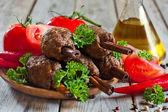 Kebab on cinnamon sticks — Stock Photo