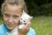 Girl hugging white cat — Stock Photo