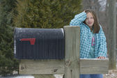 Girl in the winter by mailbox — Stock Photo