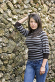 Long haired brunette woman leaning on wall — Foto Stock