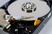Read and write head of a open harddisk drive — Stock Photo