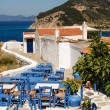 Greek tavern with blue chairs, panoramseview — Stock Photo #39144791
